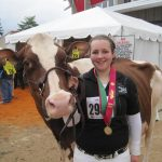 Mikayla and her Red & White Holstein Carlene (Junion Homestead Farm)